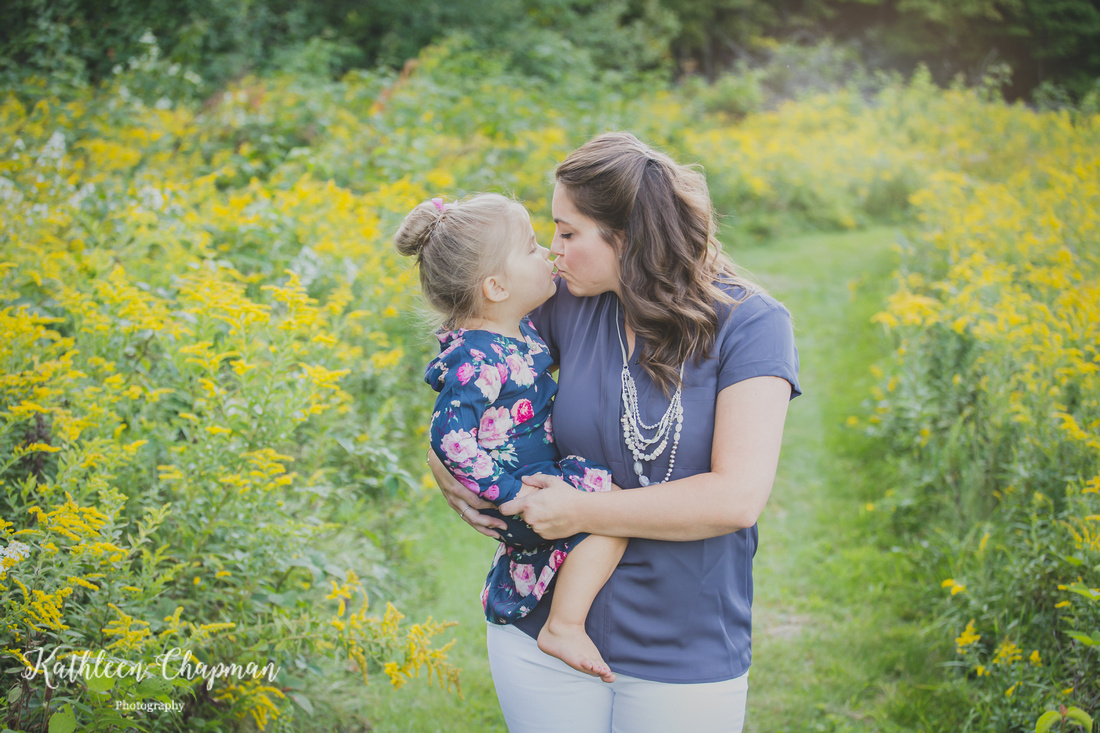 Mother and daughter kissing st. Lawrence county ny child photographer