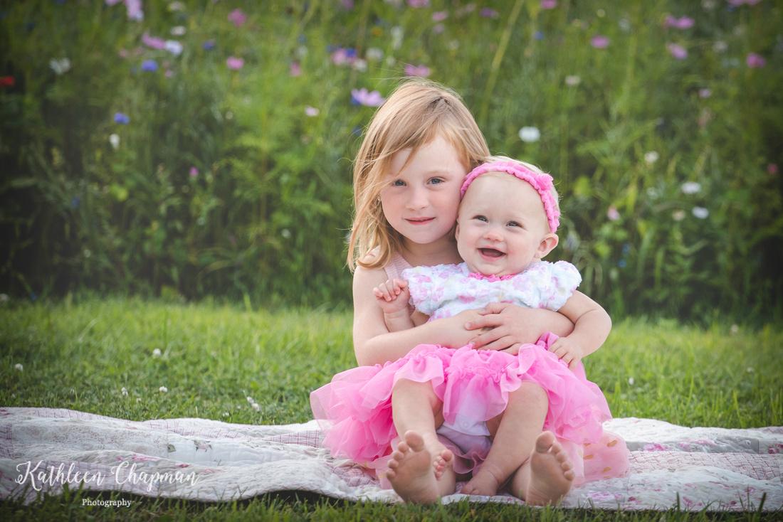 Sisters in wildflower garden | Dickinson Center family photographer
