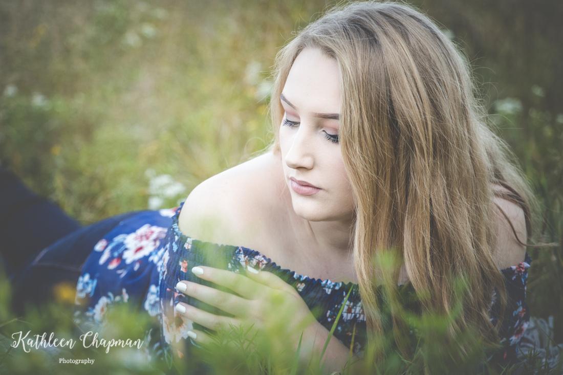 Profile of senior girl in wildflower garden   Malone NY senior photographer