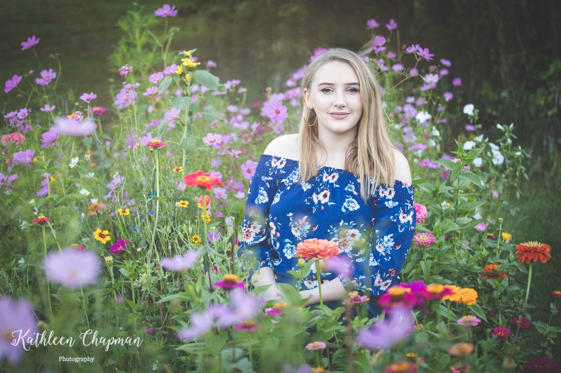 Senior girl in wildflower garden   Dickinson Center NY senior photographer