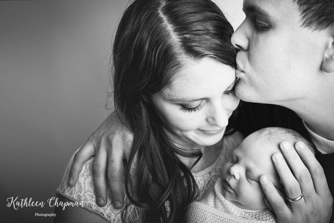 Tender kiss for mother of newborn   Potsdam NY family photographer