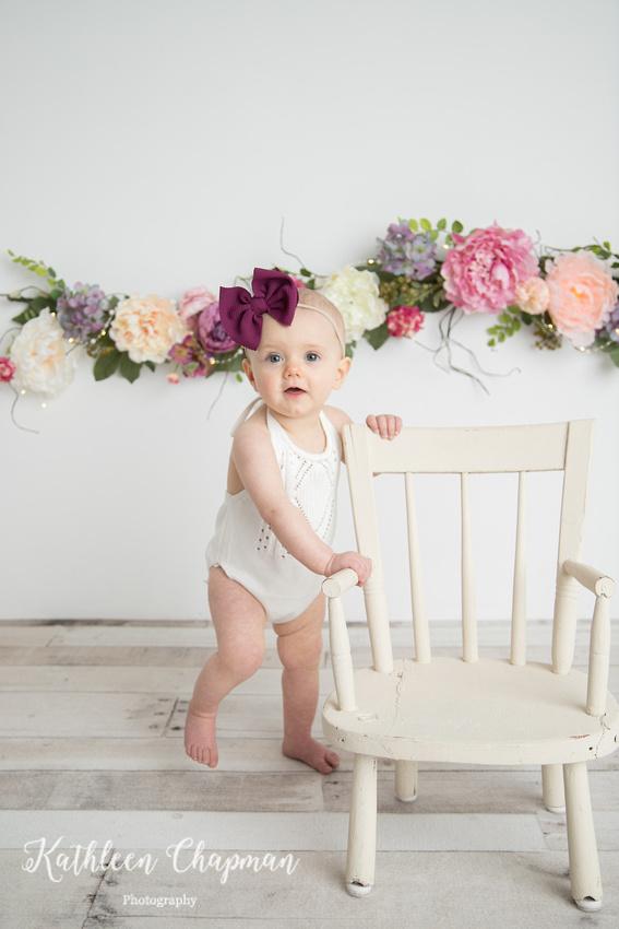 Baby girl standing 1st birthday | Massena NY child photographer