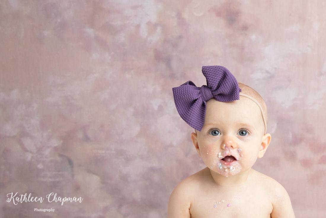 Cake on face and big eyes | Malone NY child photographer