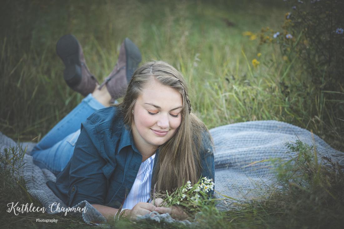 Senior girl laying in field | Potsdam NY family photographer
