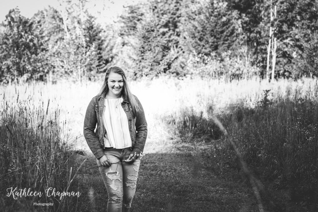 Smiling senior girl in field | Malone NY child photographer