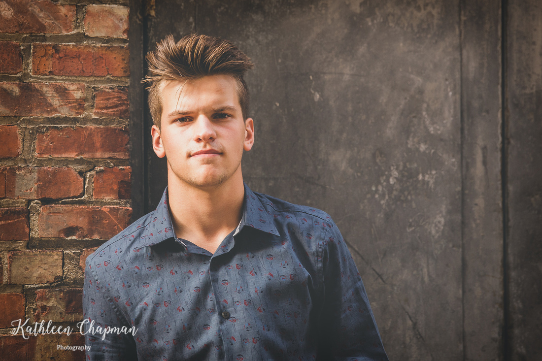 Senior guy in alley in Massena NY north country ny family photographer