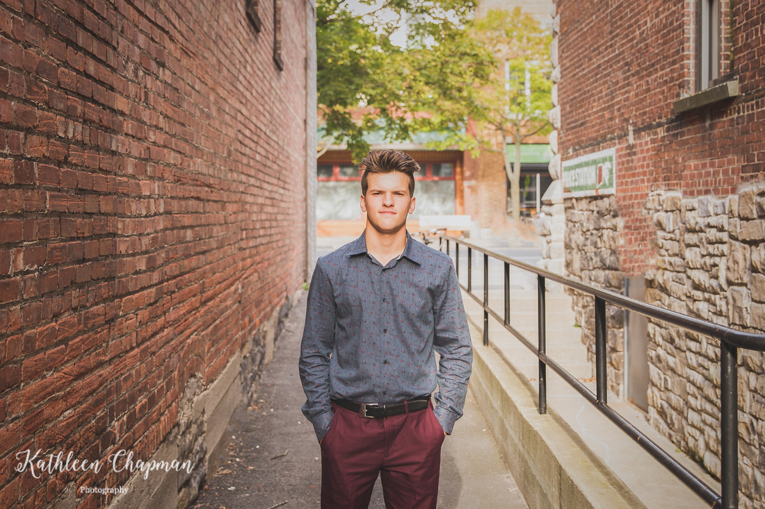 Senior guy in brick alley in Massena, NY St. Lawrence county family photographer