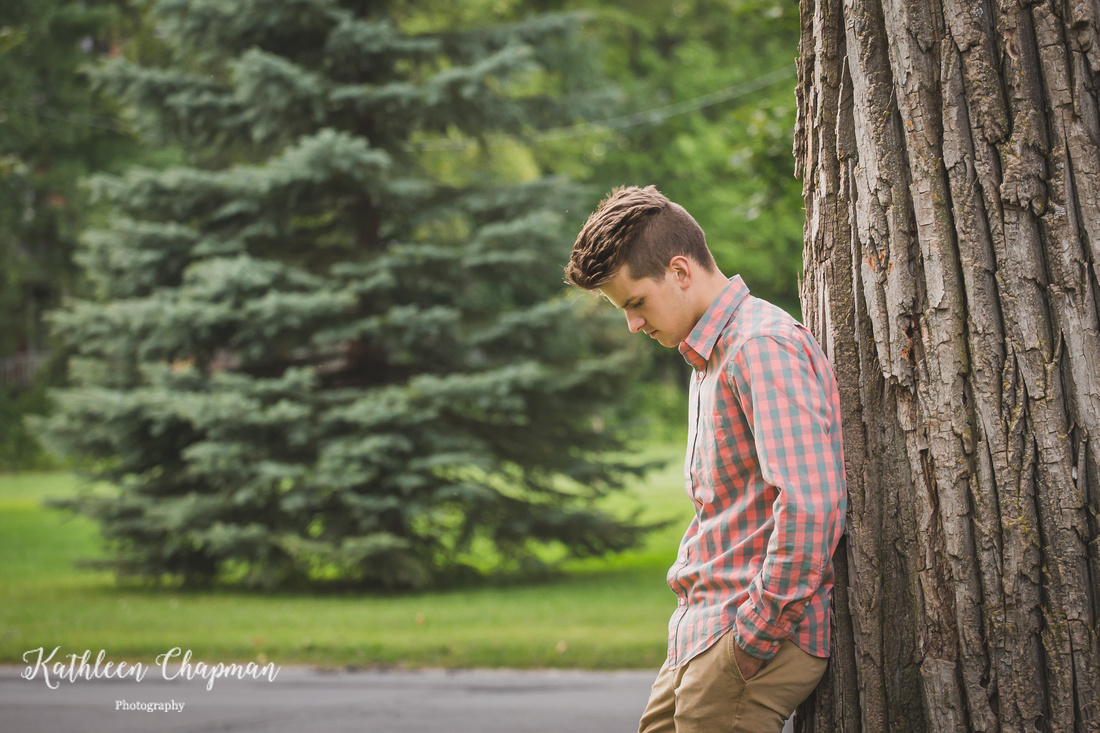 Senior boy by big tree in park in Massena NY Franklin county child photographer