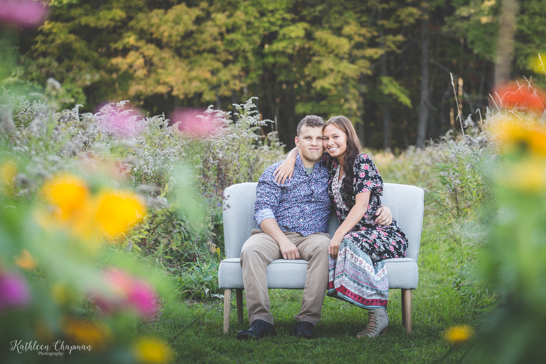 young couple in wild flowers franklin county ny child photographer