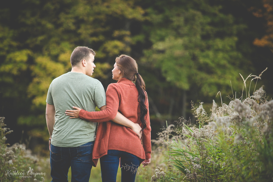 couple walking away in field north country family photographer