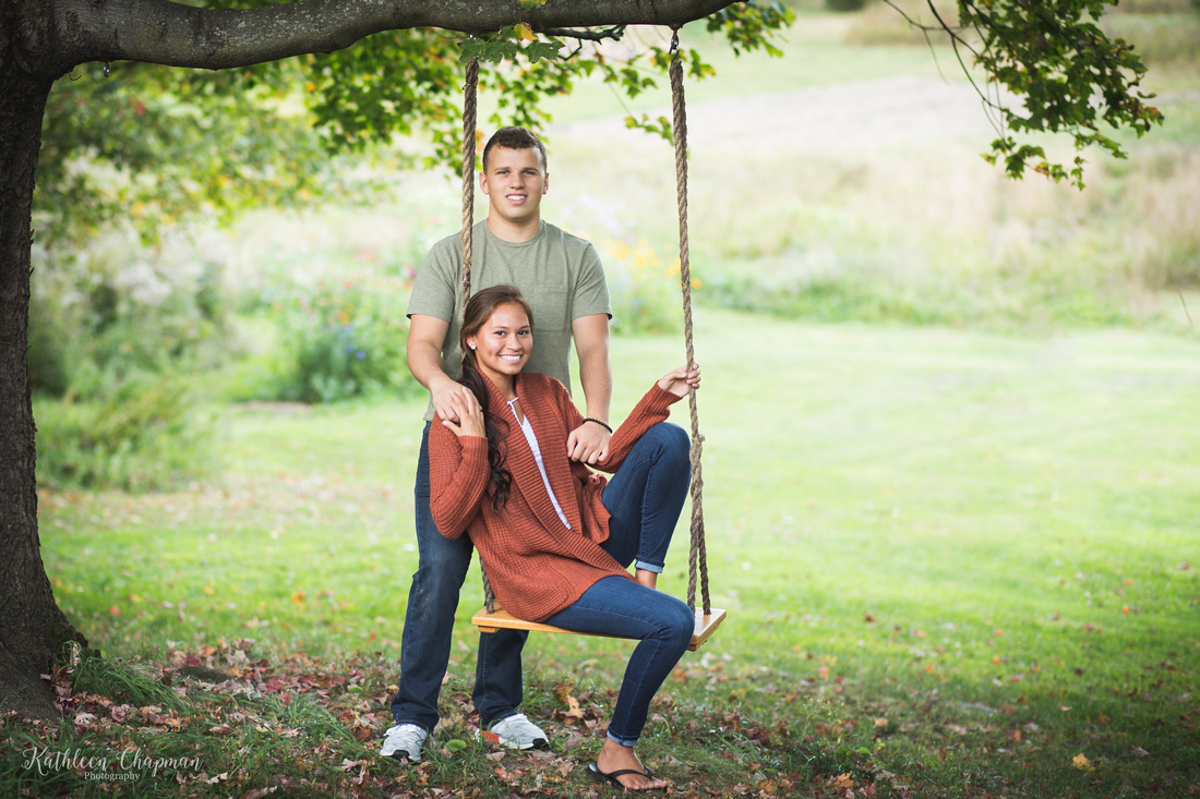 smiling couple on swing franklin country ny family photographer