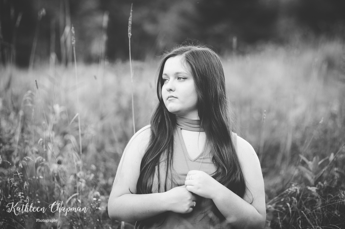 black and white portrait of senior girl in field st. lawrence county senior photographer