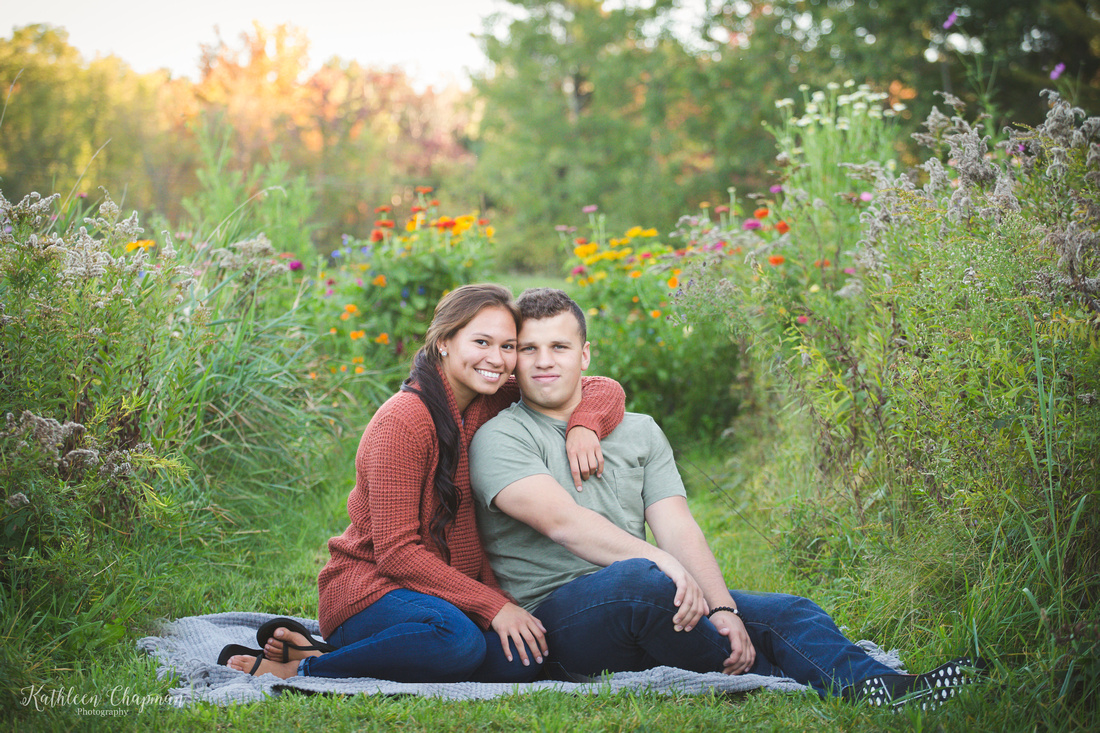 couple in wild flower garden dickinson center ny family photographer