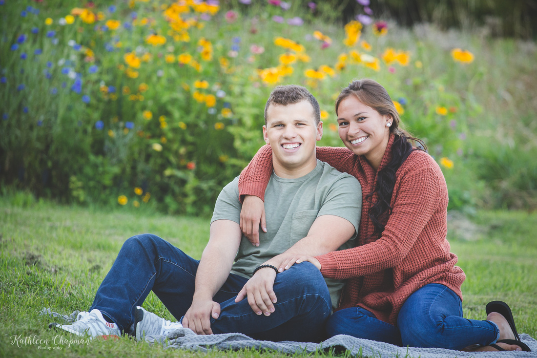 smiling couple in wild flower garden potsdam ny family photographer