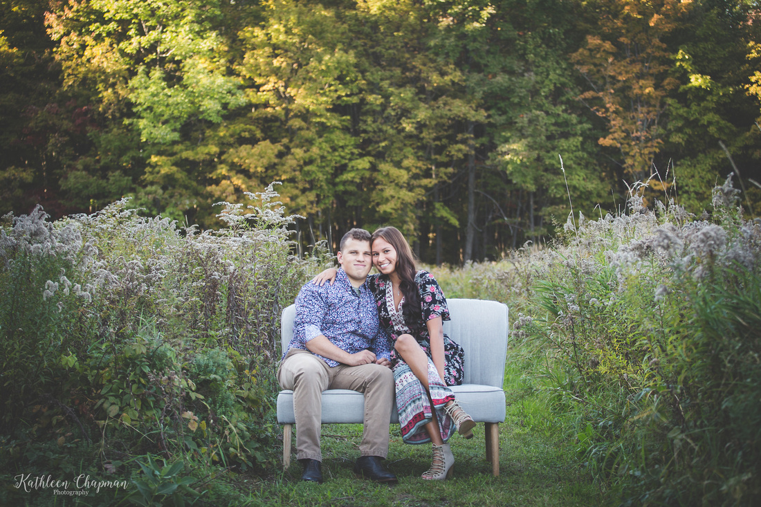 young couple snuggling on couch in field st. lawrence county ny child photographer