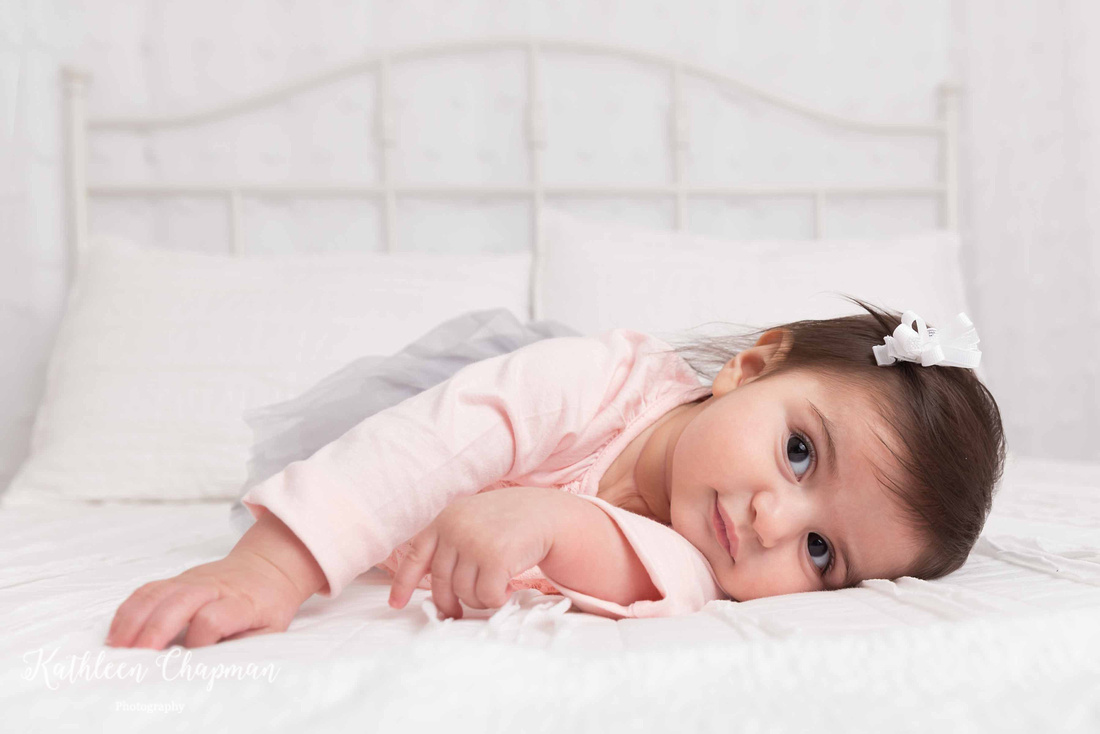 baby girl on white bed portrait potsdam ny child photographer