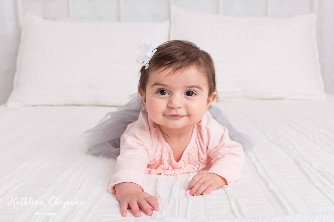 baby girl smiling on bed massena ny child photographer